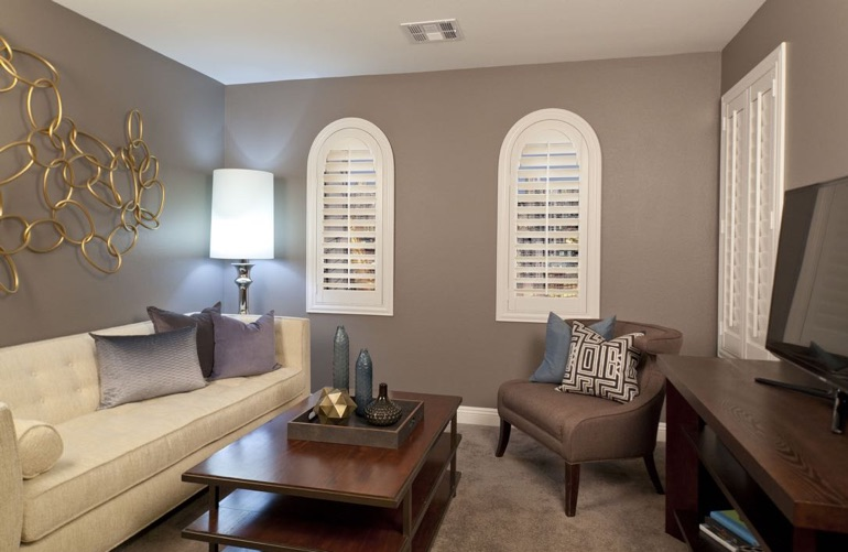 Colorado Springs family room with rounded plantation shutters.