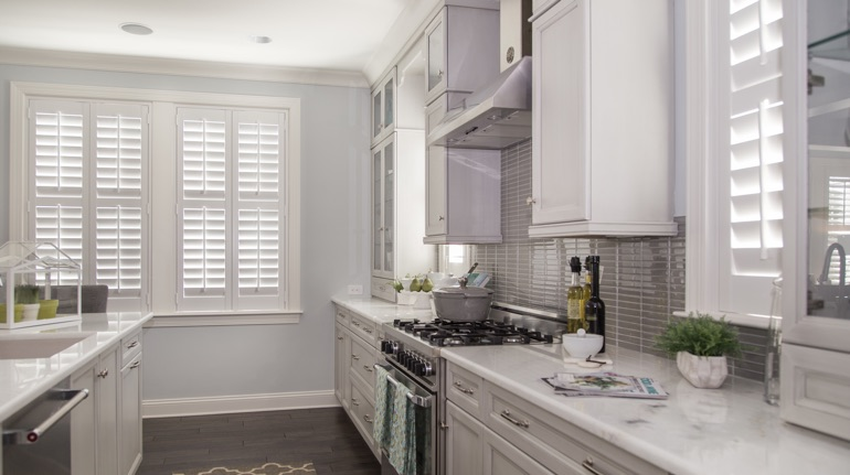 Polywood shutters in Colorado Springs kitchen with white cabinets.