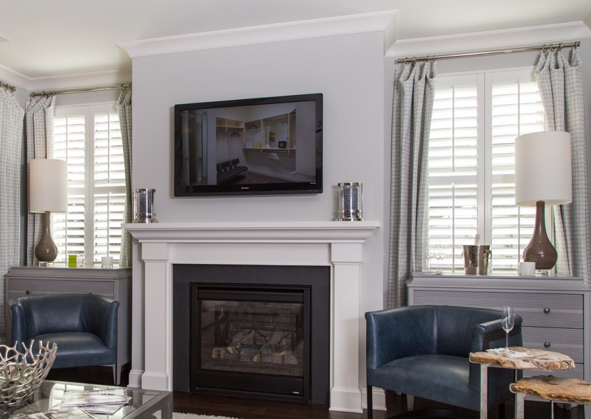 tv room Denver faux wood shutters