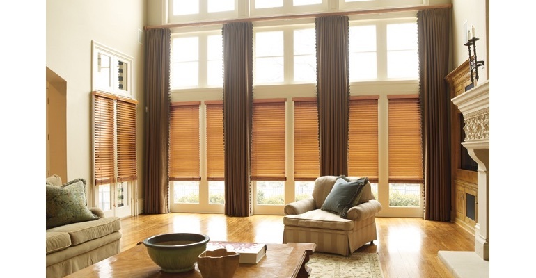 Denver great room with natural wood blinds and full-length draperies.
