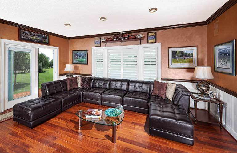 Colorado Springs basement with sliding doors and plantation shutters.