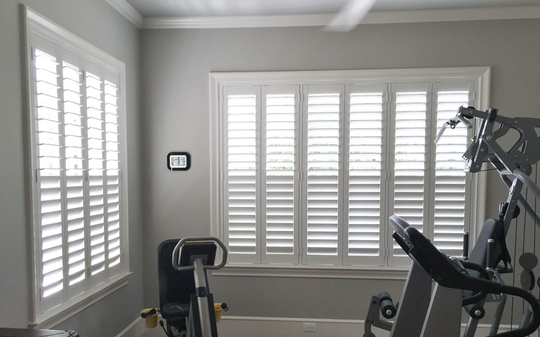 Denver fitness room with shuttered windows.