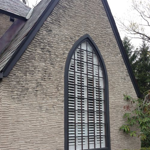 Exterior face of brick home with plantation shutters