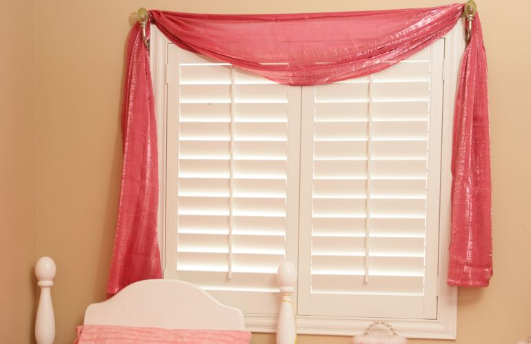 Kid's bedroom with plantation shutters.