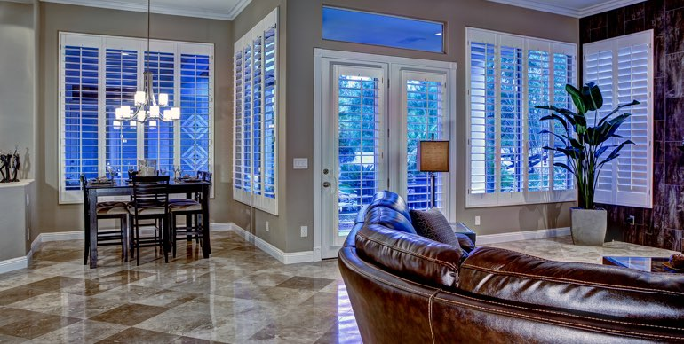Denver great room with classic shutters and modern lighting.
