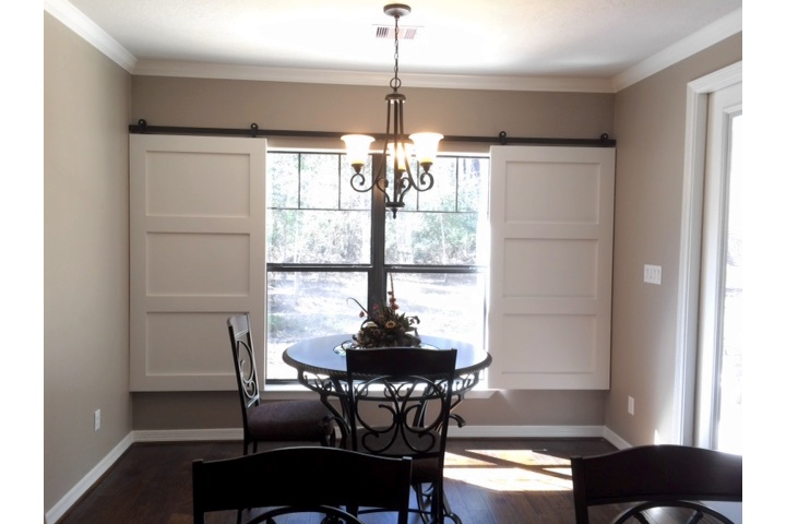 Colorado Springs dining room with classic barn door shutters.