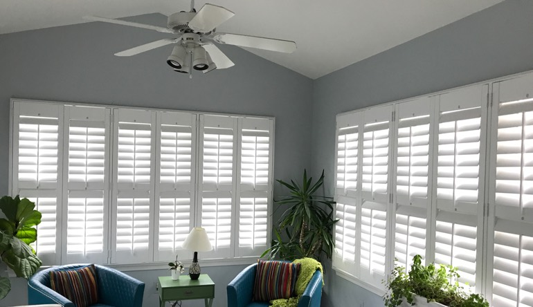 Denver living room with fan and shutters