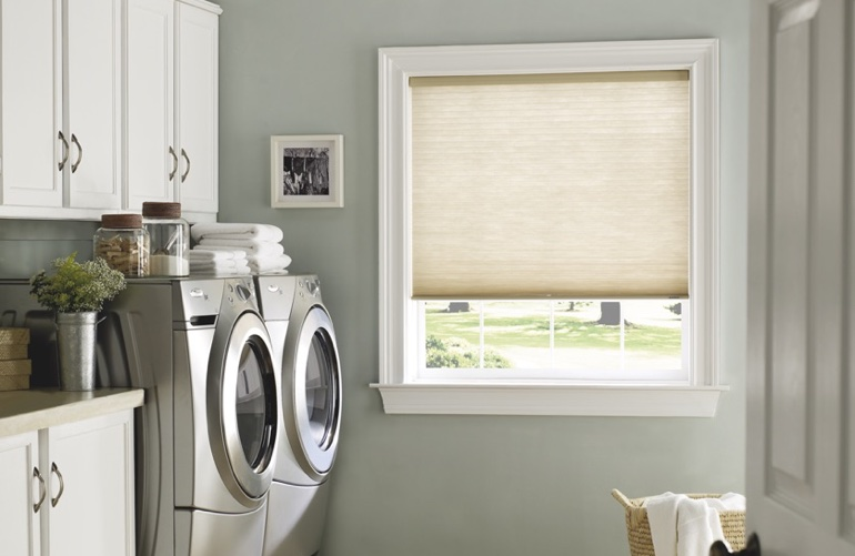 Colorado Springs laundry room with tan window shades.