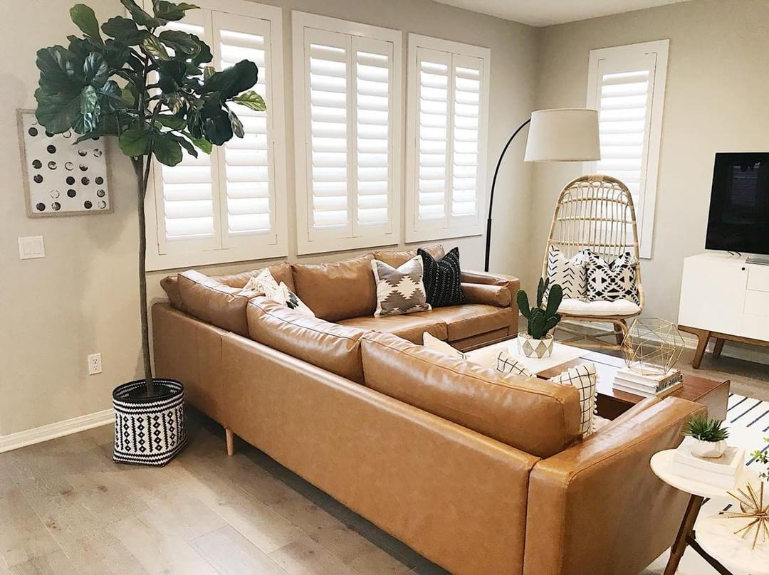 Comfortable living room with our Polywood shutters in Denver.