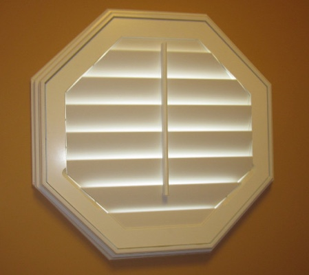 Denver octagon window with white shutter