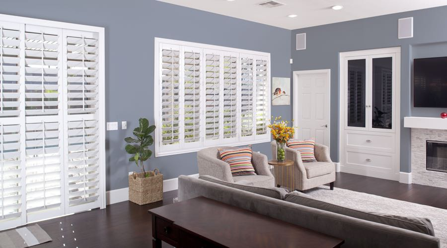 Faux Wood Shutters In pretty Denver Living Room
