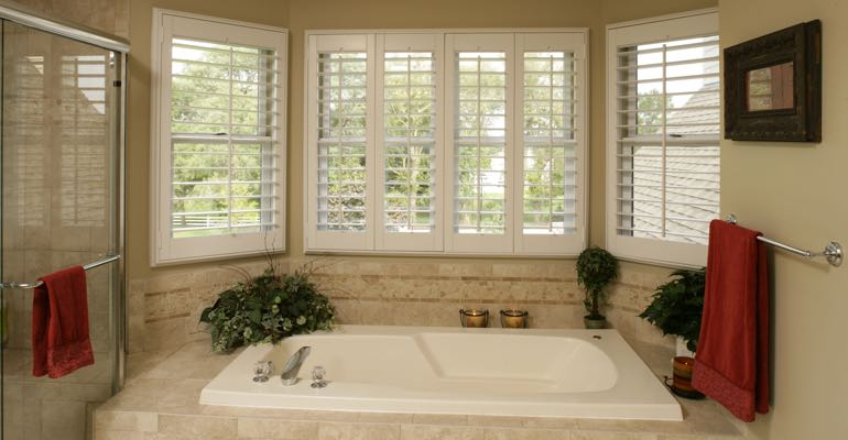 Plantation shutters in Denver bathroom.