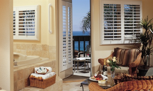 Plantation shutters on casement windows in a oceanfront condo.