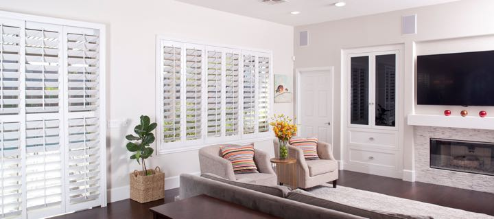 Colorado Springs living room in white with plantation shutters.