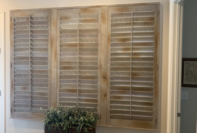 Closed reclaimed wood shutters in Denver