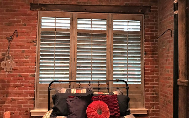 repurposed wood shutters in Denver bedroom