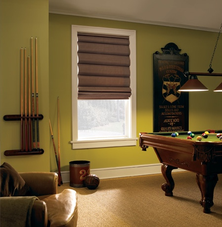 Roman shades in Denver rec room with green walls.