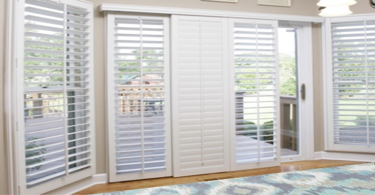 [Polywood|Plantation|Interior ]211] shutters on a sliding glass door in Colorado Springs