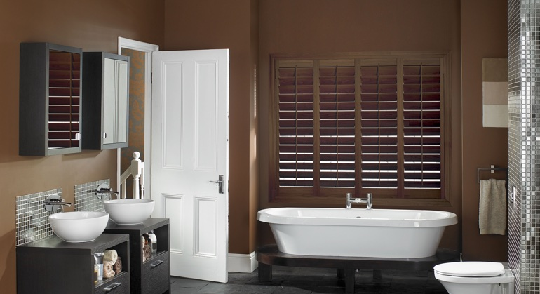 Stained wood shutter in Colorado Springs restroom