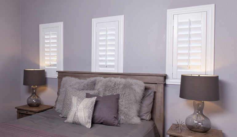 Classic plantation shutters in Colorado Springs bedroom windows.