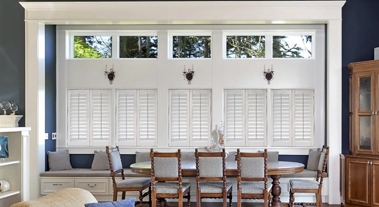 Closed classic plantation shutters in Colorado Springs dining room.