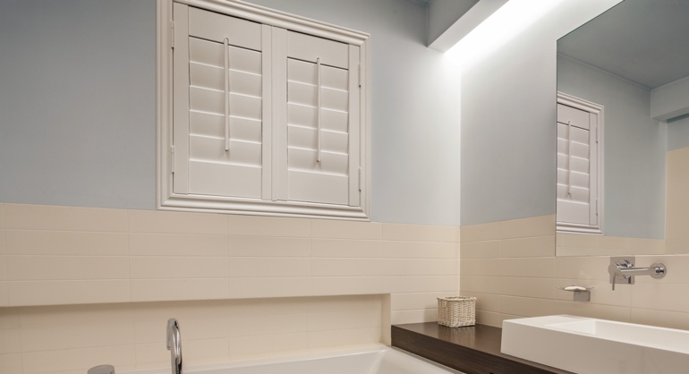 White waterproof shutters in Denver bathroom.