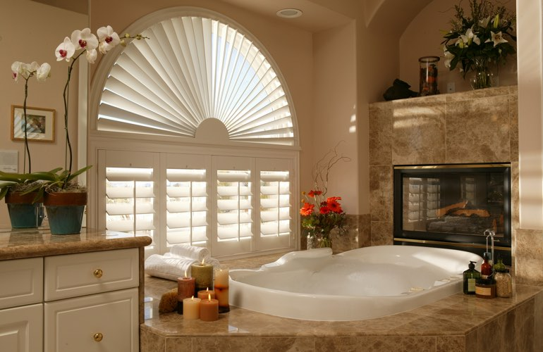 Arched shutters in a Colorado Springs bathroom.