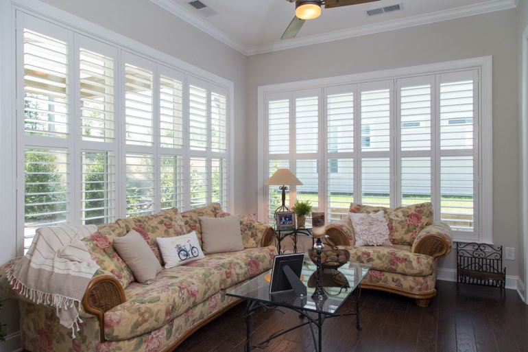 Airy sunroom with interior shutters in Denver.