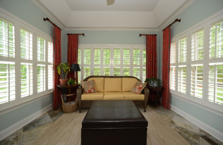Colorado Springs sunroom with beautiful window shutters.