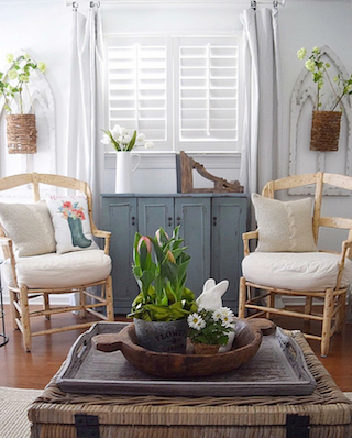 White shutters in airy sunroom.
