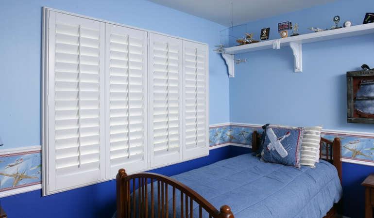 White plantation shutters in blue kids bedroom in Colorado Springs