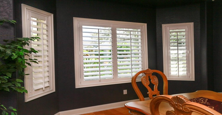 Beautiful Plantation Shutters In Dining Room With Dark Paint