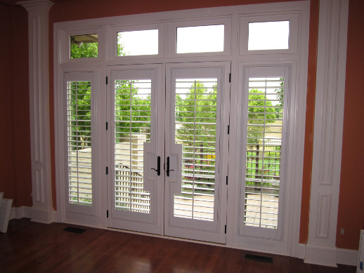 Denver patio door with sidelight shutters