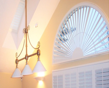 Denver arched eyebrow window with plantation shutter