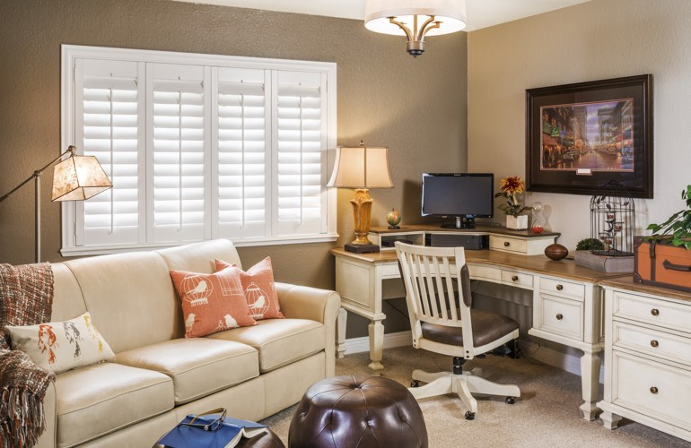 Colorado Springs home office with white window shutters.
