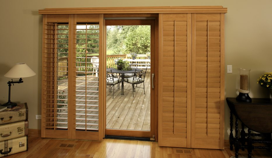 Bypass wood patio door shutters in Denver living room