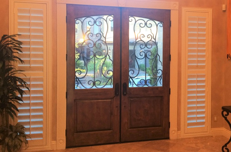 Sidelight window shutters in Denver entryway