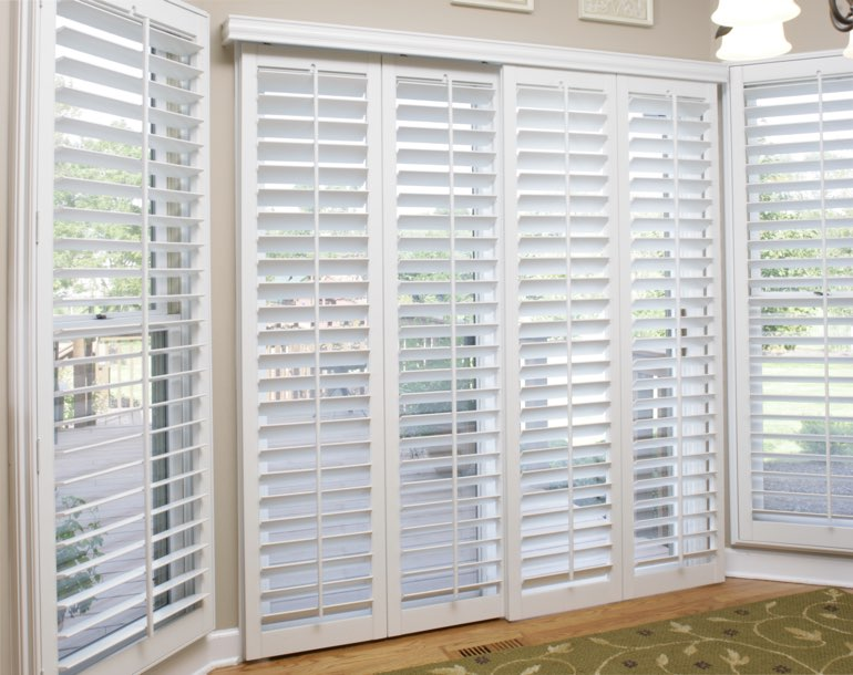 Sliding glass door with white shutters Denver