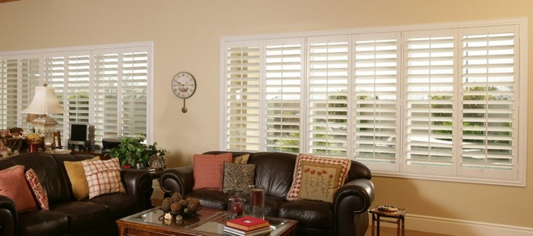 Wide window with plantation shutters in Denver living room